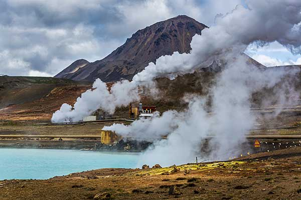 Pros and Cons of Renewable Energy - image of pond with steam