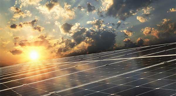 Renewable Energy Definition | Resource - Solar Panels under Sun image