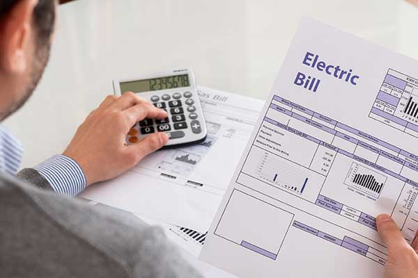 Kilowatt Hour Cost and Pricing | Man holding Bill